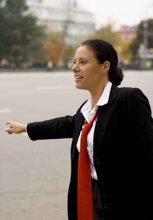 portrait of pretty hitchhiking businesswoman  Stock Photo - 3677302