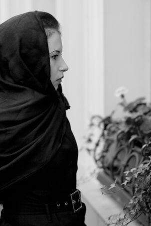 inconsolable: monochrome portrait of inconsolable widow