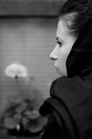 inconsolable: monochrome closeup portrait of inconsolable widow