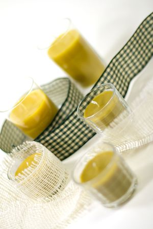 five yellow candles and green ribbon Stock Photo - 3679450