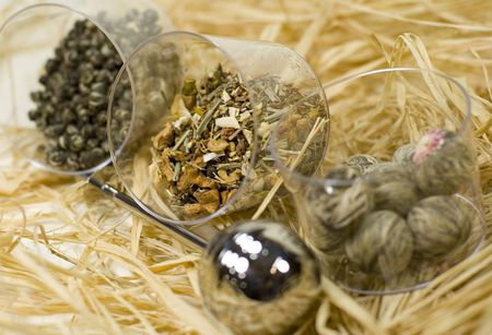 silver tea-strainer and tree kinds of tea on strow Stock Photo - 3679452