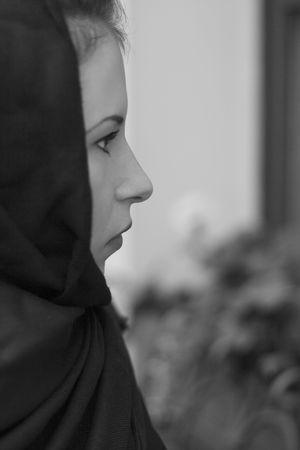 monochrome closeup portrait of inconsolable widow photo