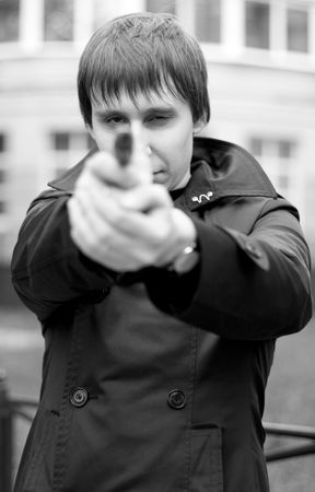 monochrome outdoor portrait of a man with gun photo