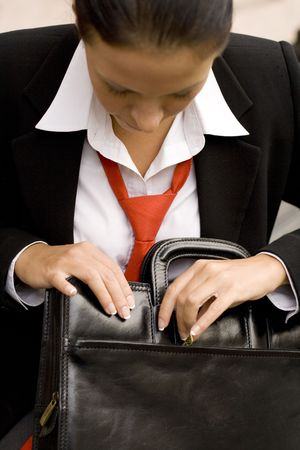 outdoor portrait of businesswoman with briefcase Stock Photo - 3682097