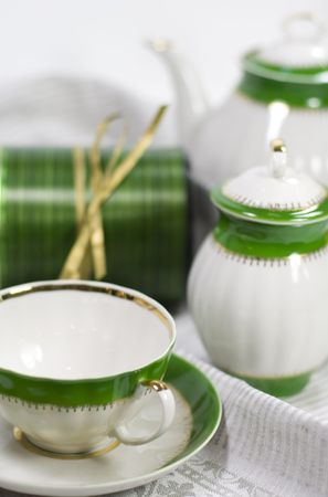 white with green tea service and gift box on napkin photo