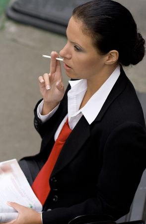 portrait of businesswoman with cigarette photo