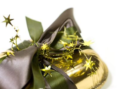 closeup of gold gift box with decorations photo