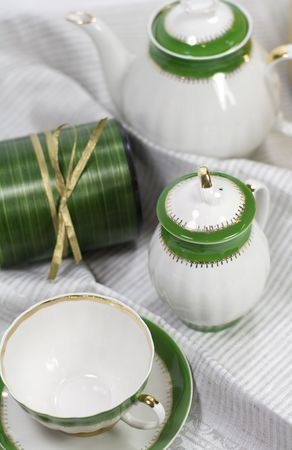 white with green tea service and gift box on napkin Stock Photo - 3695208
