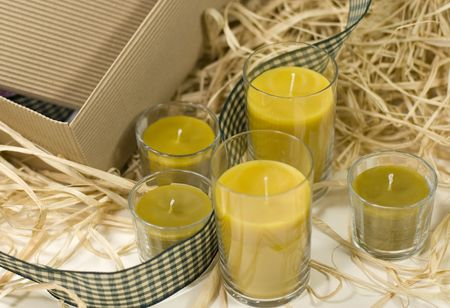 five yellow candles, ribbon and box photo