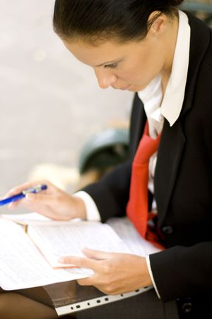 businesswoman is writing notes and planning her schedule Stock Photo - 3701395
