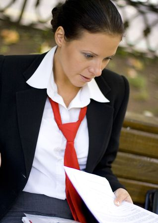 outdoor portrait of smiling businesswoman with documents photo