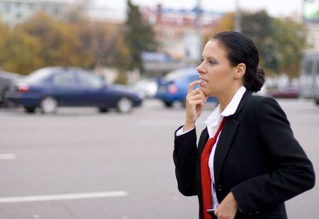 portrait of pretty hitchhiking businesswoman  Stock Photo - 3711874