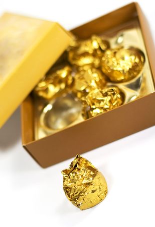 beautiful candies in box - golden colors photo