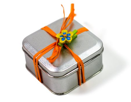 metal gift box with beautiful decoration on white background photo