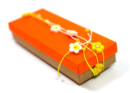 orange gift box with decoration isolated on white background Stock Photo - 3762232