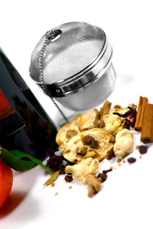 wine, dried fruits, spices and metal strainer on white background photo