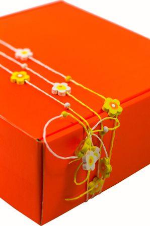orange gift box with decoration closeup photo