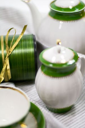 white with green tea service and gift box on napkin Stock Photo - 3868853
