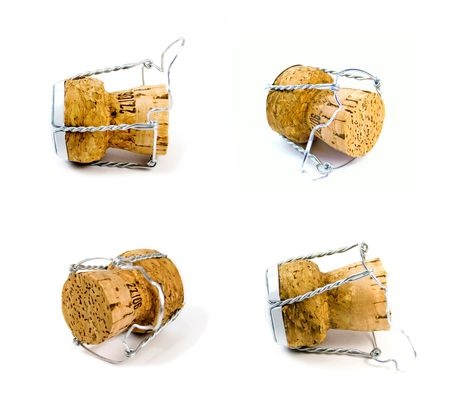 four champagne corks on white background photo
