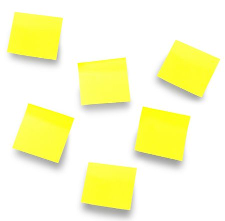 five yellow note papers on white. close-up. photo