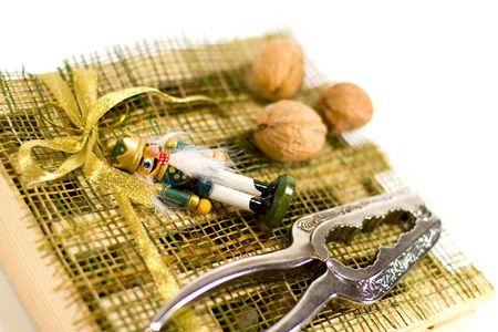 nutcracker, walnuts and xmas decorations closeup photo