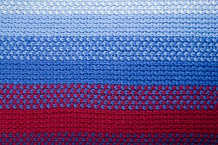 closeup of a blue and red  woolen pattern photo
