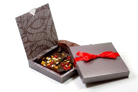 two gift boxes with chocolate on white background photo
