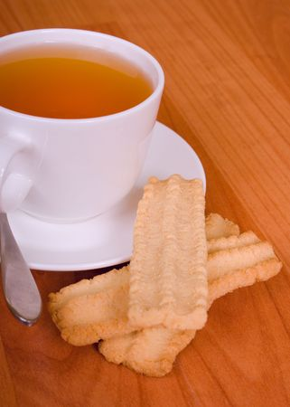 cup of tea and some cookies on wooden table Stock Photo - 4185273