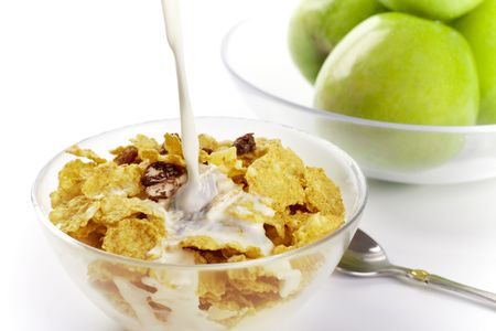 healthy breakfast: cornflakes with milk and green apples photo