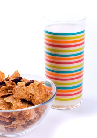 bowl with cornflakes and glass of milk photo