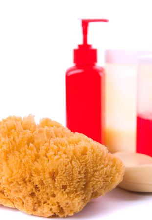 natural sponge, soap and body lotion on white background photo
