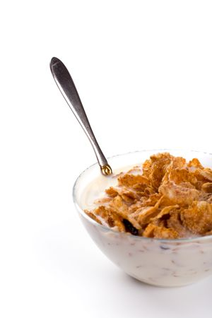 cornflakes with milk isolated on white photo
