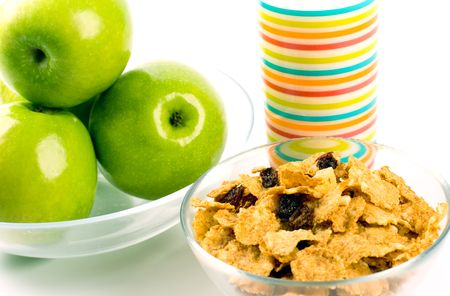 healthy breakfast: cornflakes, glass of milk and green apples photo