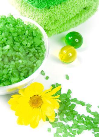 spa pruducts: bath salt, oil balls and green towells Stock Photo - 4212860