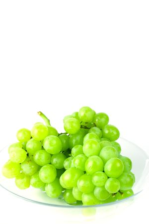 unpicked: green grapes in bowl on white background