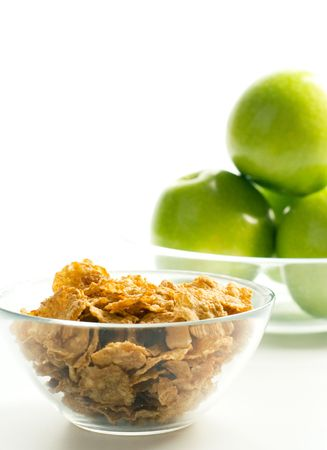 cornflakes and green apples in glass bowls on white background Stock Photo - 4212872