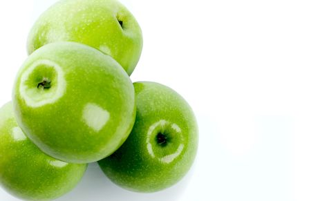 closeup of green apples on white background photo