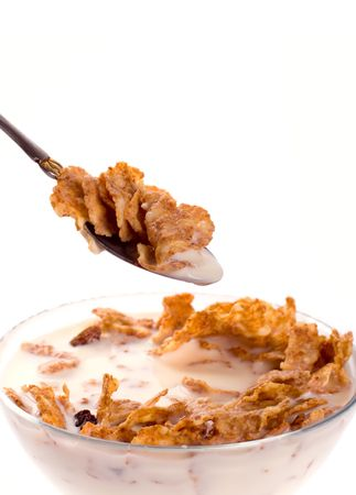 cornflakes with milk in a bowl closeup isolated on white Stock Photo - 4286960