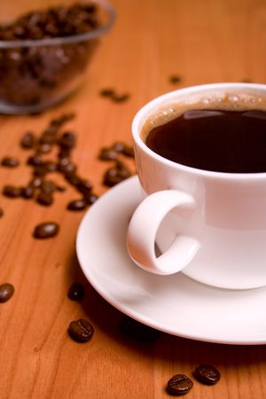 cup of coffee and beans on wooden table Stock Photo - 4286990