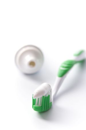 toothpaste and toothbrush on white. dental care photo
