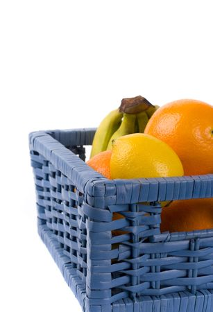 blue basket with fruits on white background Stock Photo - 4287039