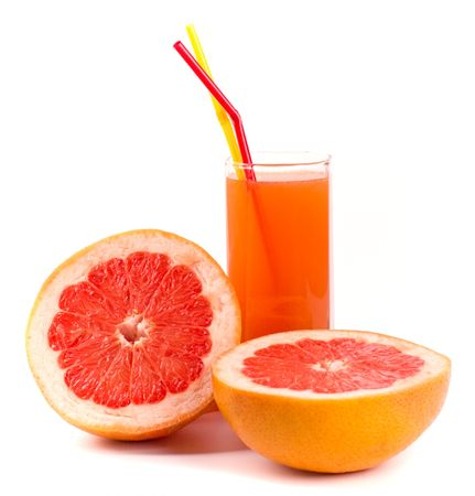 two halves of grapefruit and juice in glass on white photo