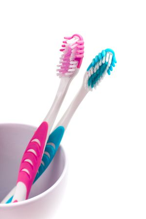 two toothbrushes on white background photo