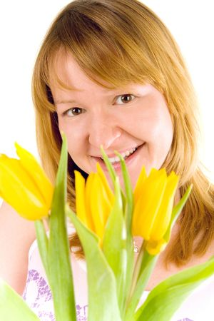 attractive young woman with yellow tulips Stock Photo - 4306517