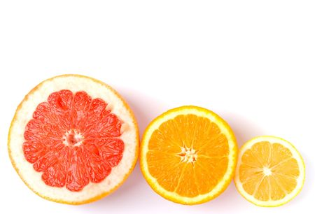 slices of an lemon, orange and grapefruit on white background photo