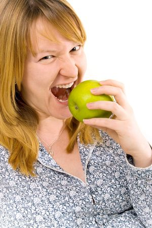 young woman eating apple over white background Stock Photo - 4325477