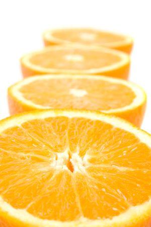 fresh oranges halves closeup on white