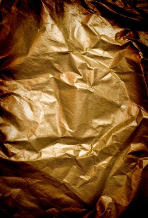 abstract background of wrinkled golden paper photo