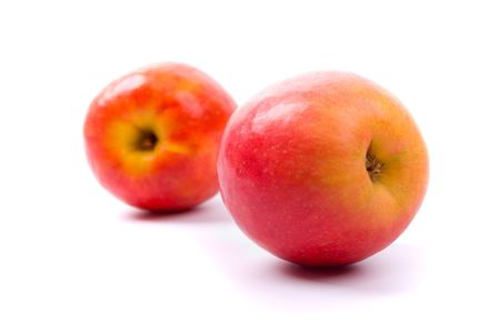 two red apples on white background photo