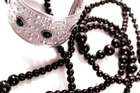 bracelet and black necklace closeup on a white background photo